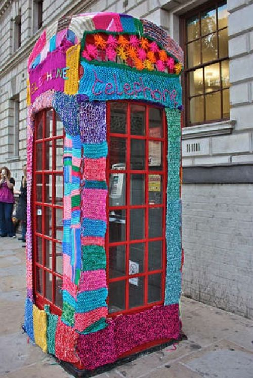 yarn bombed phone booth