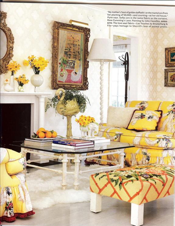 Whose flloral trellis fabric is on that ottoman???