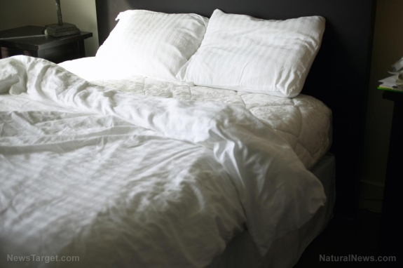 Unmade-Bed-Pillows-Sheets-Bedroom